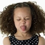 Unorthodox Life Tips represented by girl sticking out tongue