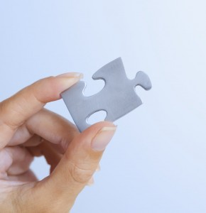 values - represented by hand holding piece of jigsaw puzzle