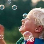let go represented by child blowing bubbles