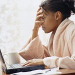 Woman sees mean comments online Using Laptop