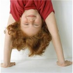 eustress shown by girl learning a handstand