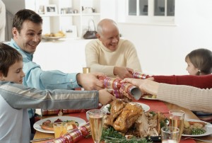 Tips for the holidays - shown by family having happy dinner
