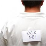 false guilt - man with kick me written on his back