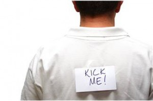 false guilt - man with kick me written on his back