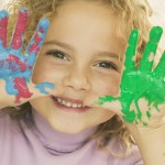 Be More Creative - shown by young girl with paint all over her hands