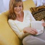 Woman Curled Up With a Good Book