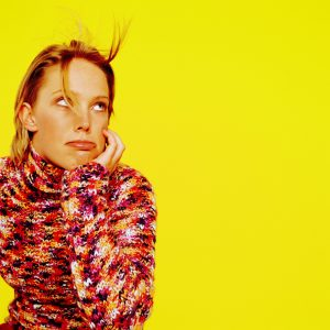 Woman Sitting with a Bored Expression --- Image by © Royalty-Free/Corbis